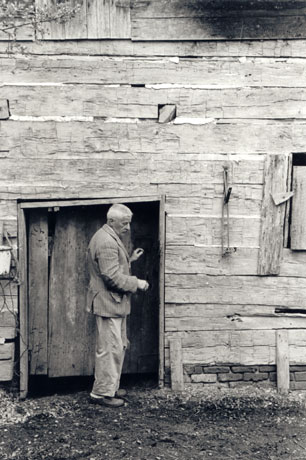 William Faulkner in front of his barn