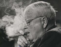 image of eastland smoking a cigar