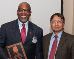 Albert L. Hilliard accepts the 2018 Engineer of Distinction award from UM School of Engineering Dean Alex Cheng